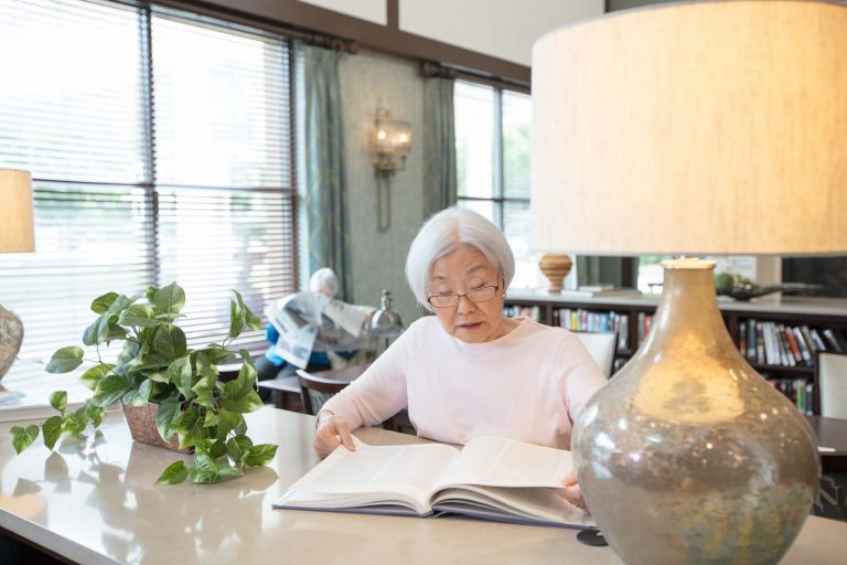 Woman explores a book of programs and activities in the library