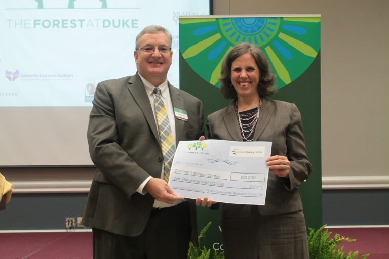 The Forest at Duke presents a check of support to the Durham Literacy Center.