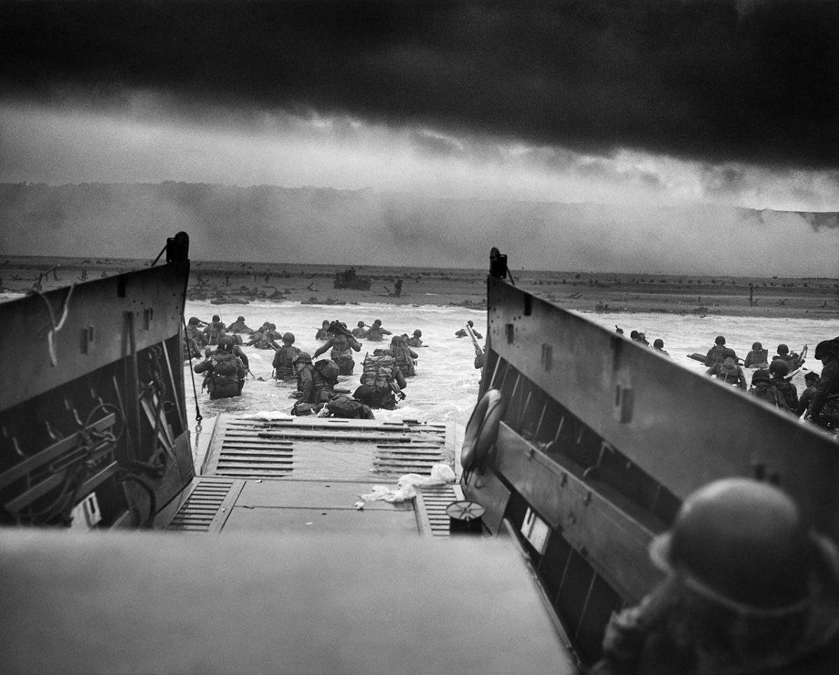 A photograph of U.S. military on the morning of D-Day at Omaha Beach.
