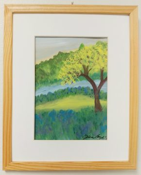 A painting of a tree by a self-taught artist hangs in a hallway