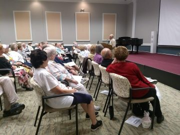 Audience members enjoy an event with the Laughter Crafters laughter club.