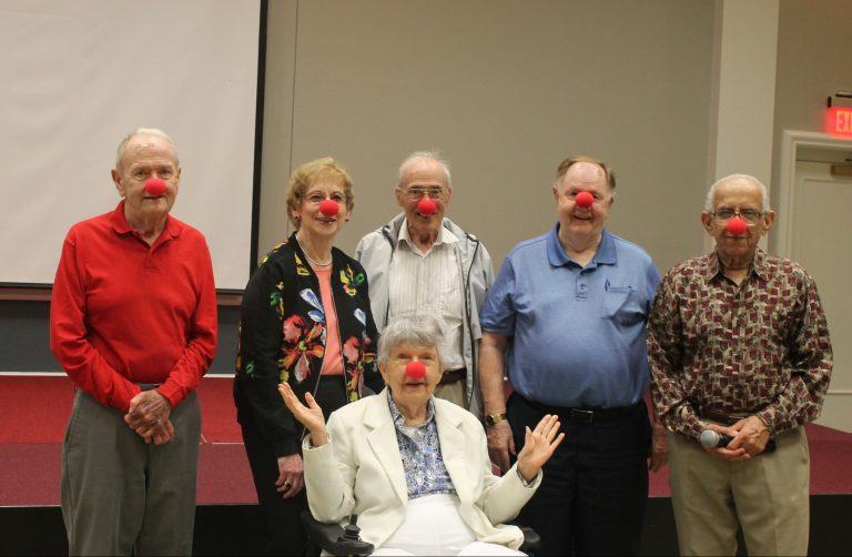 A group photograph of the Laughter Crafters committee.