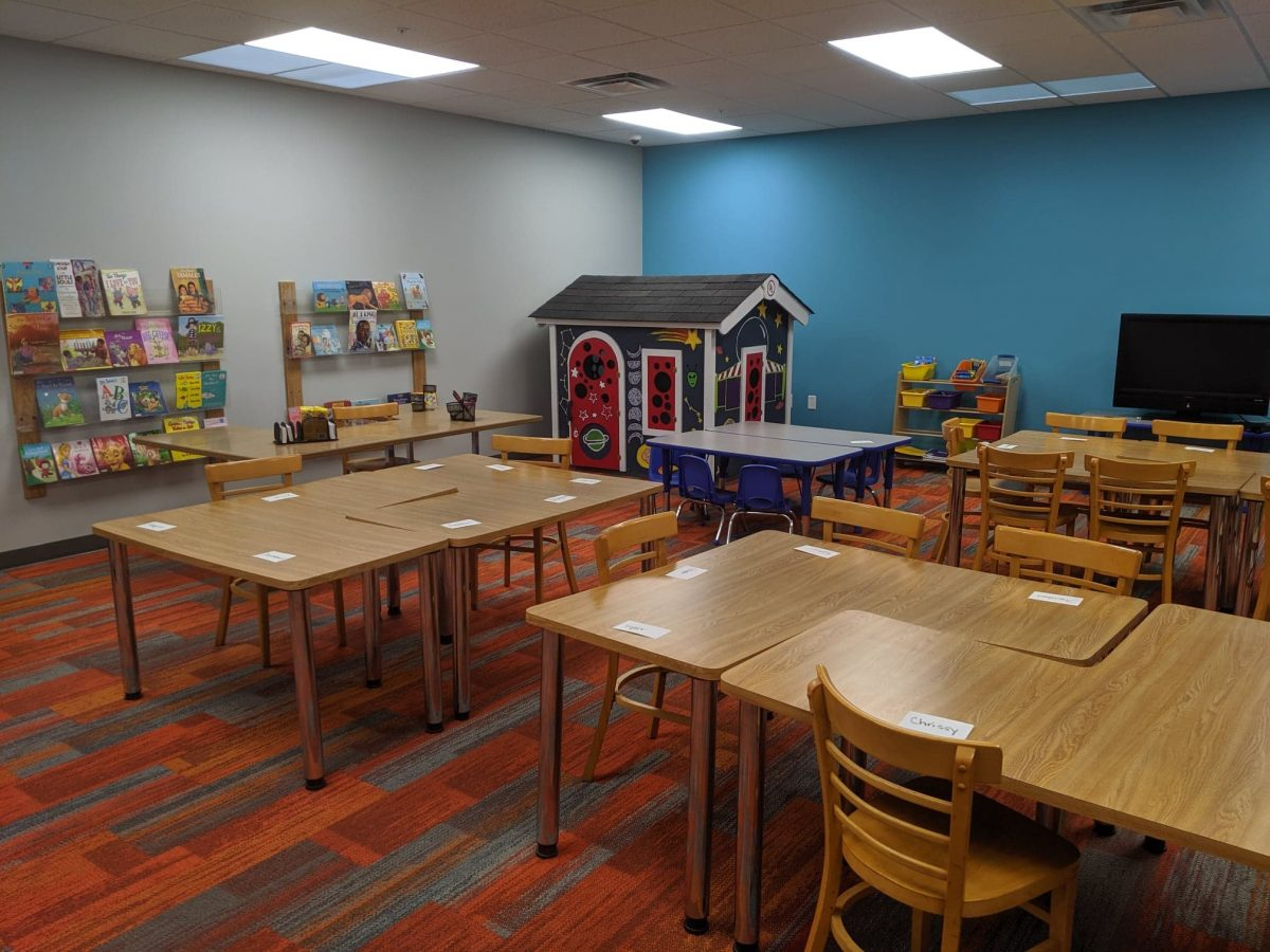 Cheerful, colorfully decorated classroom with playhouse at the new BGCDOC facility