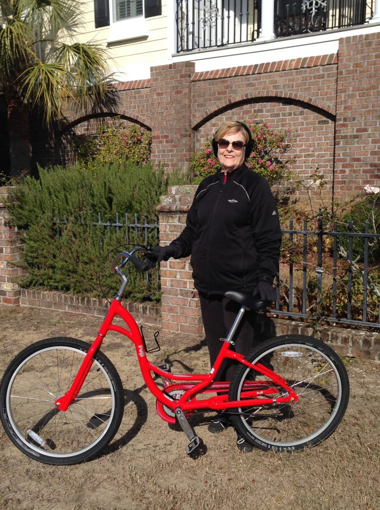 Ellen Barrett poses with her bicycle.
