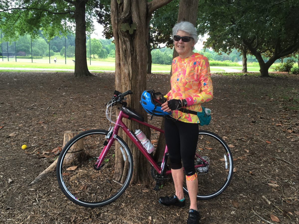 One of the Forest cyclists stands with her bicycle.