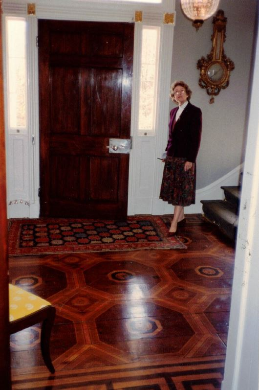 Jean Bradley Anderson stands inside an historic home
