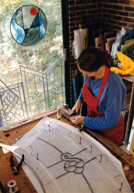 Robyn Sloan creates a stained glass panel in her studio.