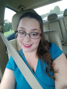 Emily Steiskal smiles in her car.
