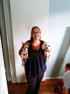 Emily Steiskal holds two dogs.